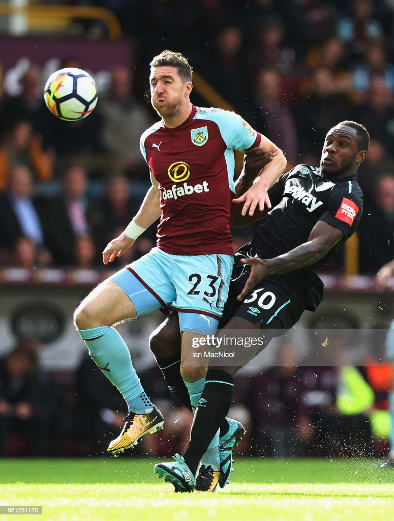 Stephen Ward of Burnley and Michail Antonio of West Ham United battle for possession during the Premier League match between Burnley and West Ham United at Turf Moor on October 14, 2017 in Burnley, England.