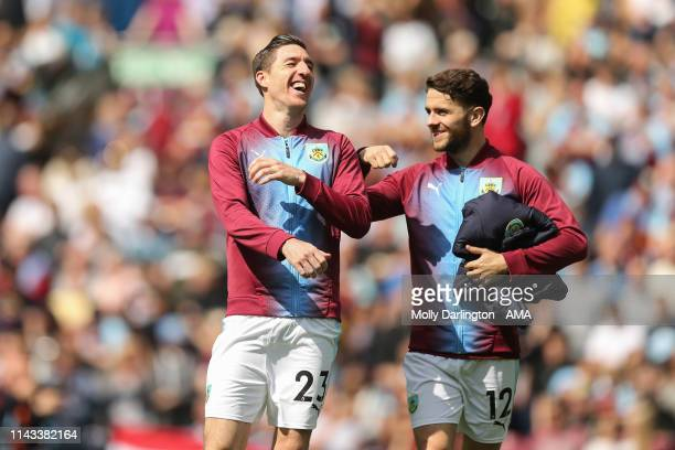Stephen Ward of Burnley and Robbie Brady of Burnley during the Premier League match between Burnley FC and Arsenal FC at Turf Moor on May 12 2019 in...