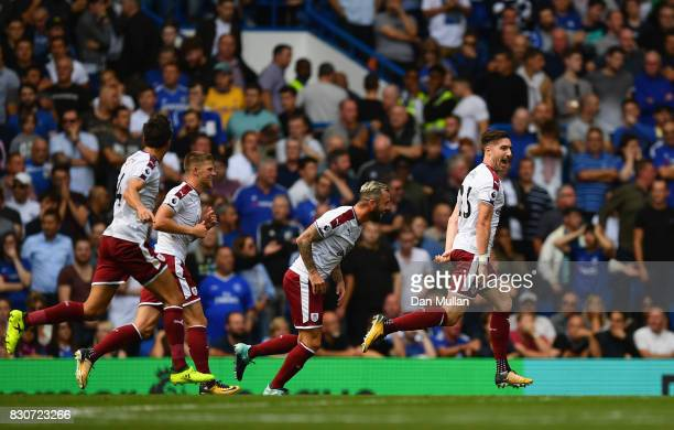 Stephen Ward of Burnley celebrates scoring his sides second goal during the Premier League match between Chelsea and Burnley at Stamford Bridge on...