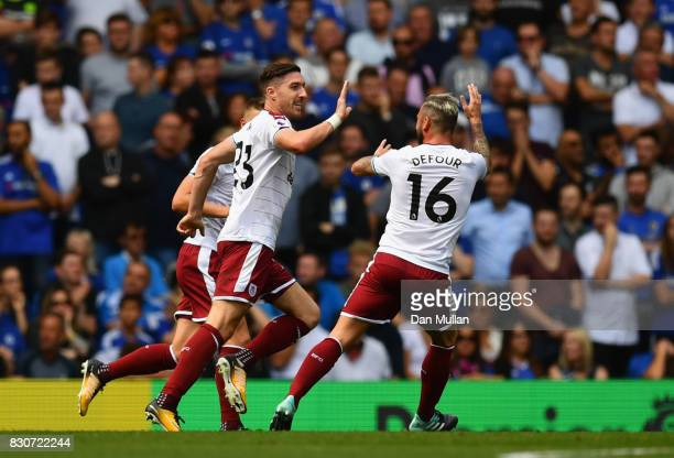 Stephen Ward of Burnley celebrates scoring his sides second goal with Steven Defour of Burnley during the Premier League match between Chelsea and...