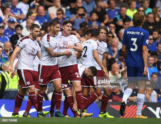 Stephen Ward of Burnley celebrates scoring his sides third goal with his team mates during the Premier League match between Chelsea and Burnley at...
