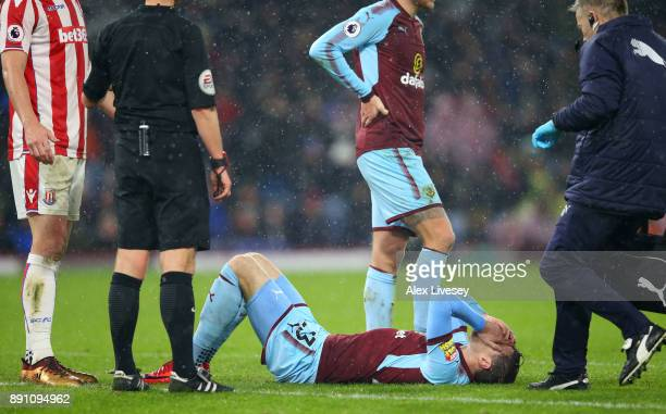 Stephen Ward of Burnley goes down injured during the Premier League match between Burnley and Stoke City at Turf Moor on December 12 2017 in Burnley...