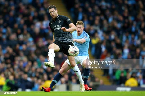 Stephen Ward of Burnley is challenged by Kevin De Bruyne of Manchester Ciy during the FA Cup Fourth Round match between Manchester City and Burnley...