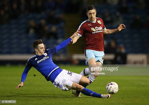 Stephen Ward of Burnley is tackled by Tom Lawrence of Cardiff City during the Sky Bet Championship match between Burnley and Cardiff City at Turf...