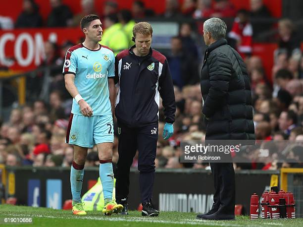 Stephen Ward of Burnley leaves the pitch after picking up an injury during the Premier League match between Manchester United and Burnley at Old...