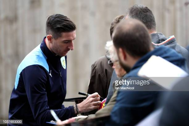 Stephen Ward of Burnley signs autographs as he arrives at the stadium prior to the Premier League match between Burnley FC and AFC Bournemouth at...