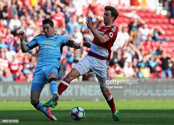 Stephen Ward of Burnley tackles Patrick Bamford of Middlesbrough during the Premier League match between Middlesbrough and Burnley at Riverside...