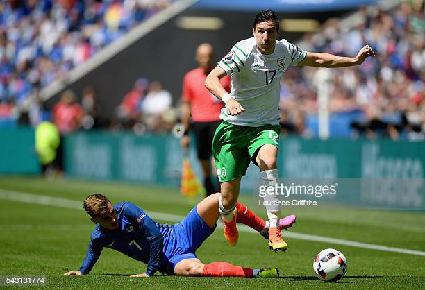 Stephen Ward of Republic of Ireland is tackled by Antoine Griezmann of France during the UEFA EURO 2016 round of 16 match between France and Republic...