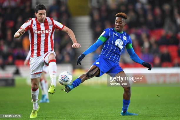 Stephen Ward of Stoke City and Jamal Lowe of Wigan Athletic in action during the Sky Bet Championship match between Stoke City and Wigan Athletic at...