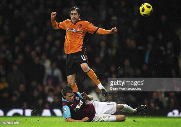 Stephen Ward of Wolverhampton Wanderers is tackled by Radoslav Kovac of West Ham United during the Barclays Premier League match between West Ham...