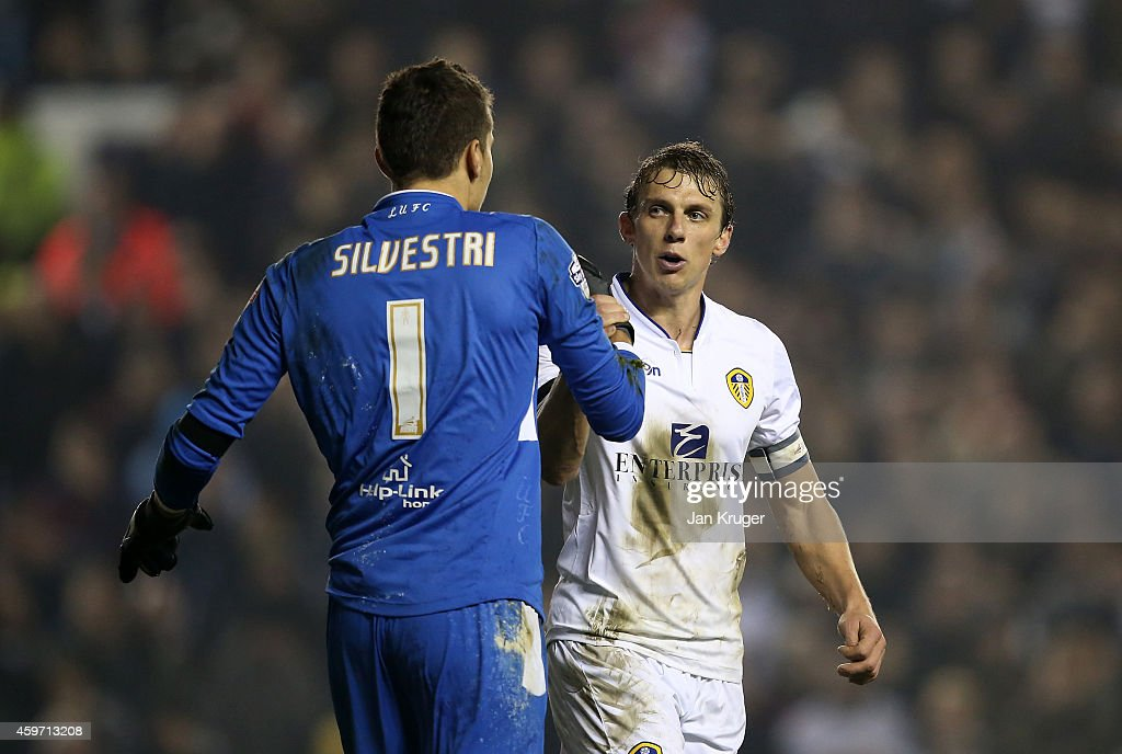 Stephen Warnock and Marco Silvestri, Goalkeeper of Leeds celebrate the win during the Sky Bet Championship match between Leeds United and Derby County at Elland Road on November 29, 2014 in Leeds, England.