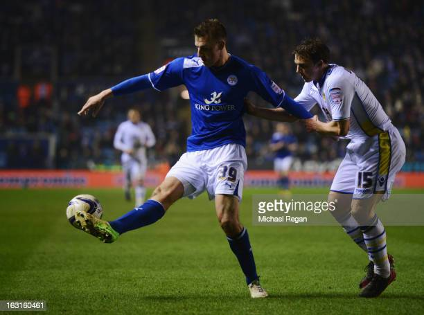 Stephen Warnock of Leeds United tangles with Chris Wood of Leicester City during the npower Championship match between Leicester City and Leeds...