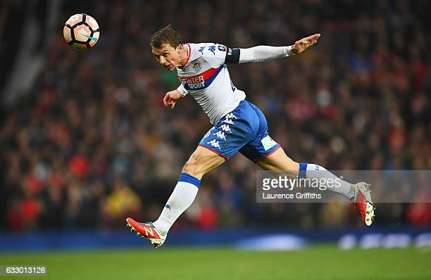 Stephen Warnock of Wigan Athletic heads the ball during the Emirates FA Cup Fourth round match between Manchester United and Wigan Athletic at Old...