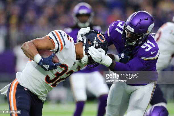 Stephen Weatherly of the Minnesota Vikings tackles David Montgomery of the Chicago Bears in the first quarter at U.S. Bank Stadium on December 29,...