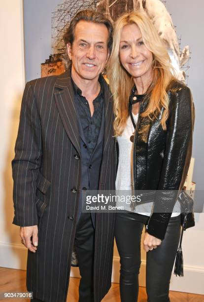 """Stephen Webster and Melissa Odabash attend the private view of """"JR: Giants - Body of Work"""" at Lazinc on January 10, 2018 in London, England."""