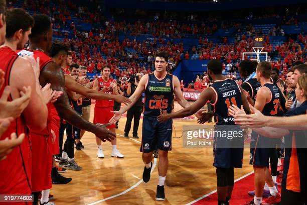 Stephen Weigh of the Taipans walks thru a guard of honour after retiring from the game following the round 19 NBL match between the Perth Wildcats...
