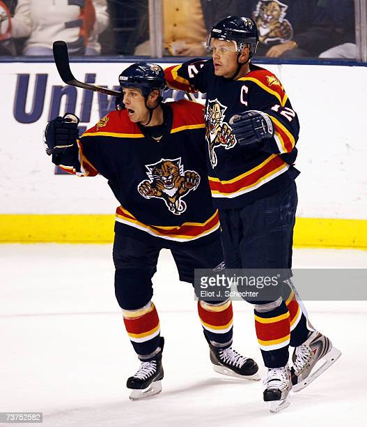 Stephen Weiss and Olli Jokinen of the Florida Panthers celebrate teammate Martin Gelinas' game winning goal in overtime against the Washington...
