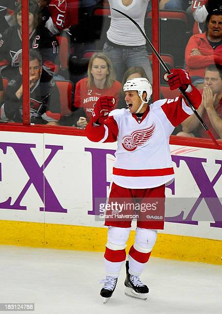 Stephen Weiss of the Detroit Red Wings celebrates after his gamewinning goal in overtime against the Carolina Hurricanes during play at PNC Arena on...