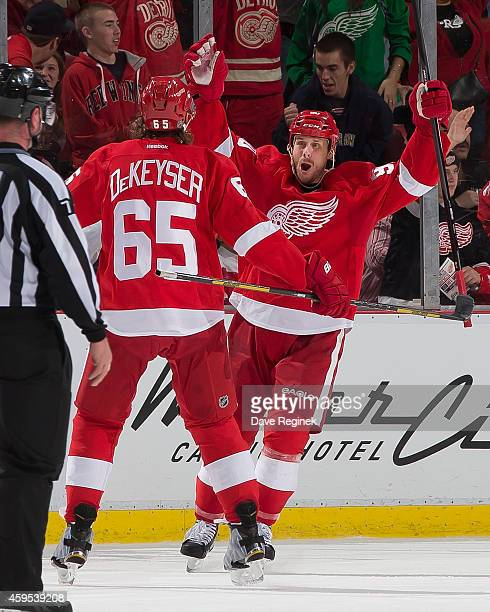 Stephen Weiss of the Detroit Red Wings celebrates his first goal of the season in the second period with teammate Danny DeKeyser during a NHL game...