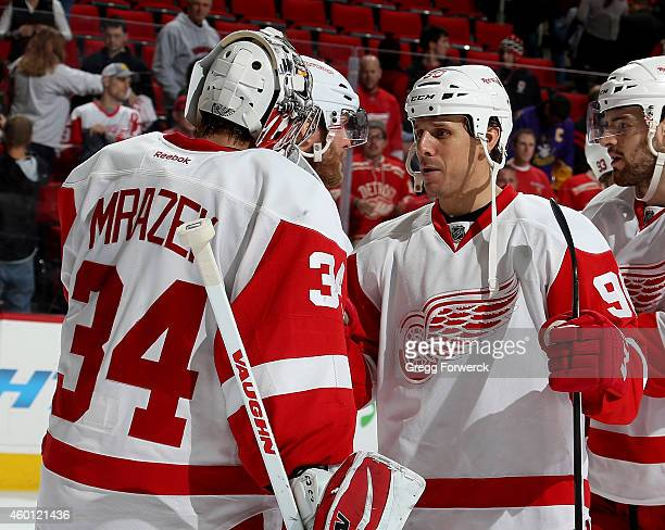 Stephen Weiss of the Detroit Red Wings congratulates goaltender Petr Mrazek after a win over the Carolina Hurricanes at PNC Arena on December 7 2014...