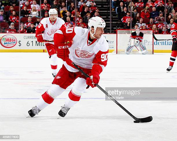 Stephen Weiss of the Detroit Red Wings plays the puck against the New Jersey Devils during the game at the Prudential Center on November 28 2014 in...