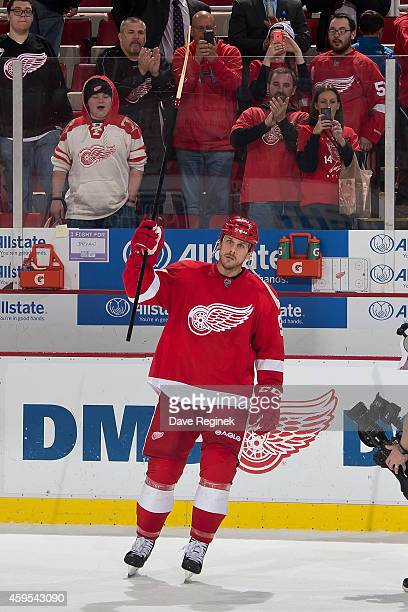 Stephen Weiss of the Detroit Red Wings skates out and salutes the crowd after being named the number one star of the game for scoring two goal in the...