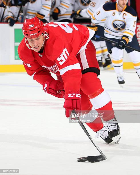 Stephen Weiss of the Detroit Red Wings skates skates with the puck during an NHL game against the Buffalo Sabres at Joe Louis Arena on October 2 2013...