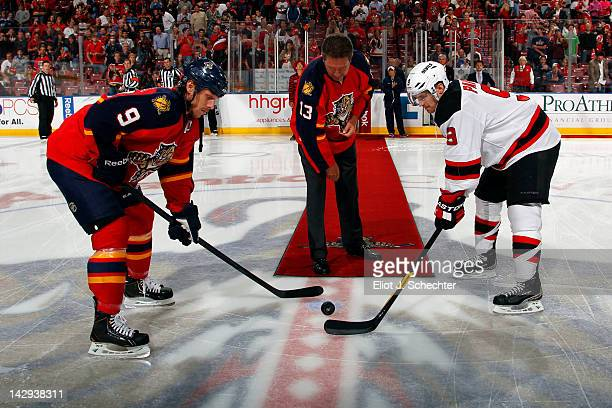 Stephen Weiss of the Florida Panthers and Dainius Zubrus of the New Jersey Devils stand by while Former Miami Dolphin Quarterback Dan Marino drops...