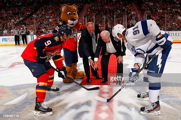 Stephen Weiss of the Florida Panthers and Steven Stamkos of the Tampa Bay Lightning stand by for the ceremonial puck drop with Brian Skrudland and...