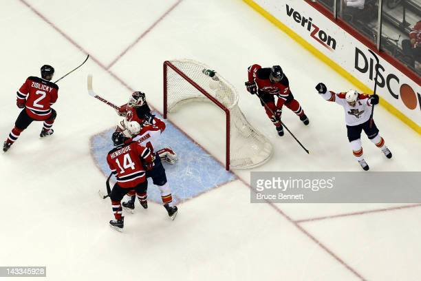 Stephen Weiss of the Florida Panthers celebrates after Kris Versteeg scored a second period goal against goalie Martin Brodeur of the New Jersey...