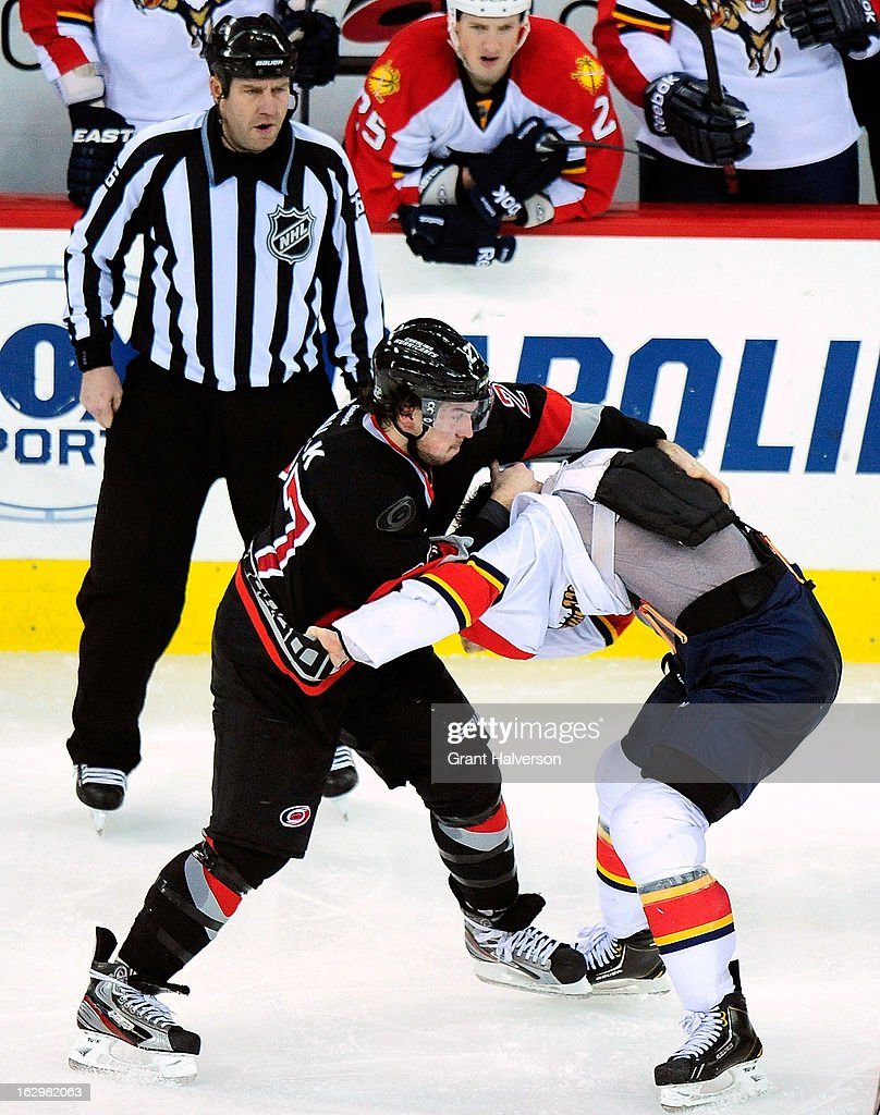 Stephen Weiss #9 of the Florida Panthers fights with Justin Faulk #27 of the Carolina Hurricanes during play at PNC Arena on March 2, 2013 in Raleigh, North Carolina. The Hurricanes won 6-2.