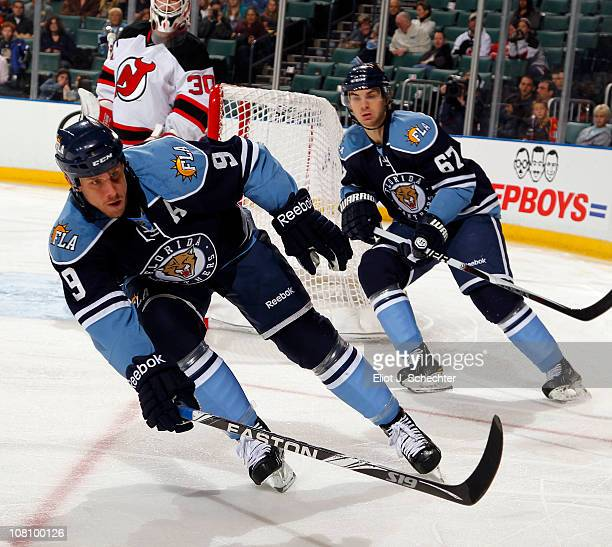 Stephen Weiss of the Florida Panthers skates for position with teammate Michael Frolik against the New Jersey Devils at the BankAtlantic Center on...