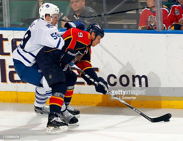 Stephen Weiss of the Florida Panthers skates with the puck against Keith Aulie of the Toronto Maple Leafs at the BankAtlantic Center on March 17 2011...