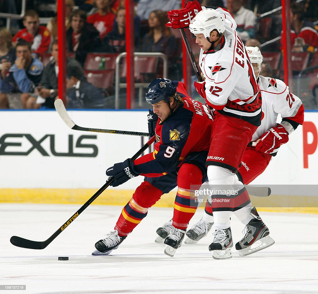 Stephen Weiss #9 of the Florida Panthers skates with the puck against Eric Staal #12 of the Carolina Hurricanes at the BB&T Center on January 19, 2013 in Sunrise, Florida.