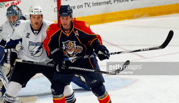 Stephen Weiss of the Florida Panthers tangles with Eric Brewer of the Tampa Bay Lightning at the BankAtlantic Center on March 12 2011 in Sunrise...