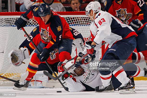 Stephen Weiss of the Florida Panthers tangles with Joel Ward and teammate Jay Beagle of the Washington Capitals at the BankAtlantic Center on...