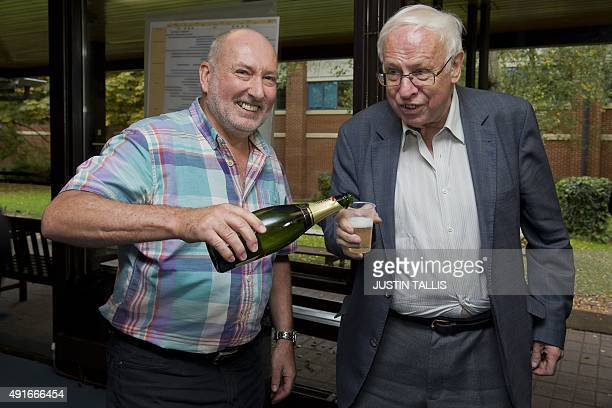 Stephen West deputy director of Clare Hall pours Sweden's Tomas Lindahl emeritus director of Cancer Research UK a cup of champagne at Clare Hall...