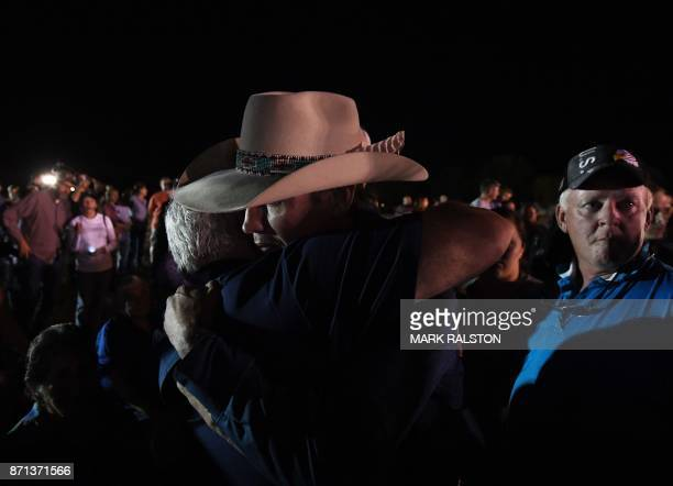 Stephen Willeford and Johnnie Langendorff who both chased after suspected killer Devin Kelley hug during a vigil in Sutherland Springs Texas on...