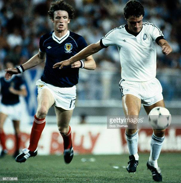 Stephen Wooddin races past Allan Evans of Scotland during the Scotland v New Zealand World Cup match held in Malaga Spain on the 15th of June 1982...