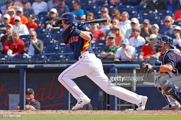 Stephen Wrenn hits a single driving in Garrett Stubbs the Houston Astros against the Detroit Tigers for the game winning run in the ninth inning...