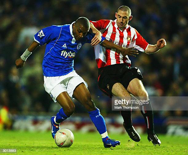 Stephen Wright of Sunderland tackles Clinton Morrison of Birmingham City during the FA Cup Fifth Round Replay match between Birmingham City and...