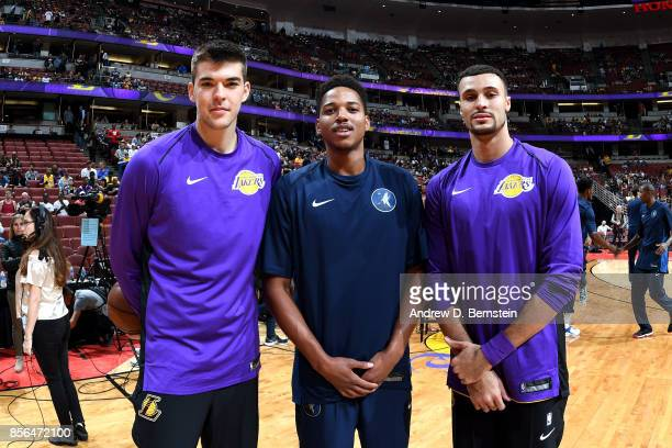 Stephen Zimmerman and Larry Nance Jr #7 of the Los Angeles Lakers pose for a picture with Anthony Brown of the Minnesota Timberwolves during the...