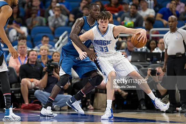 Stephen Zimmerman of the Orlando Magic defends the ball against Gorgui Dieng of the Minnesota Timberwolves on November 9 2016 at Amway Center in...