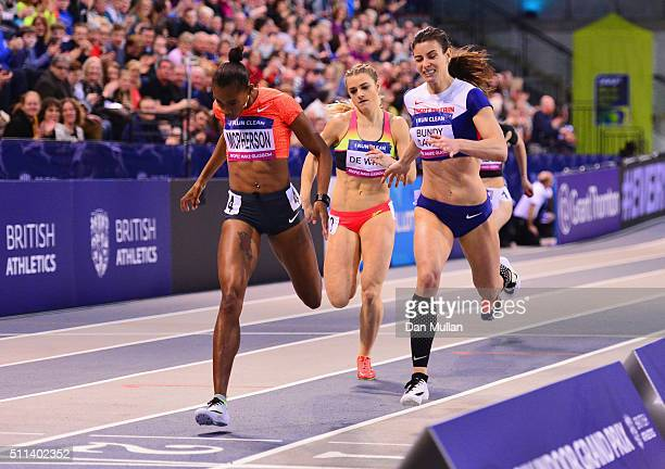 Stephenie Ann McPherson of Jamaica crosses the line ahead of Seren BundyDavies of Great Britain to win the the Women's 400 metres final during the...