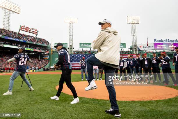 Stephon Gilmore Julian Edelman and Rob Gronokwsi of the New England Patriots throw out a ceremonial first pitch during the Boston Red Sox 2018 World...