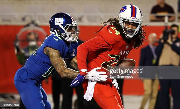 Stephon Gilmore of the AFC intercepts the ball in the endzone as Odell Beckham Jr of the NFC defends in the first half during the NFL Pro Bowl at the...
