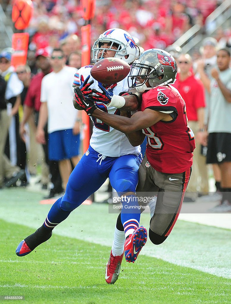Stephon Gilmore #24 of the Buffalo Bills breaks up a pass for Skye Dawson #18 of the Tampa Bay Buccaneers at Raymond James Stadium on December 8 2013 in Tampa, Florida.