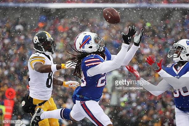 Stephon Gilmore of the Buffalo Bills can't make an interception thrown by Ben Roethlisberger of the Pittsburgh Steelers during the first half at New...