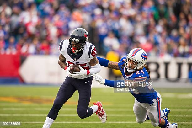 Stephon Gilmore of the Buffalo Bills fails to stop Nate Washington of the Houston Texans during the first half on December 6 2015 at Ralph Wilson...