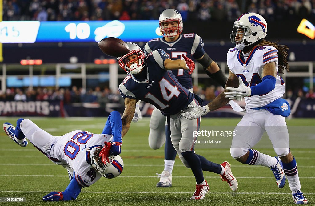 Stephon Gilmore #24 of the Buffalo Bills intercepts a pass intended for Chris Harper #14 of the New England Patriots during the fourth quarter at Gillette Stadium on November 23, 2015 in Foxboro, Massachusetts.